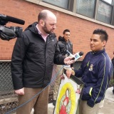 Edgar Muniz speaking with a reporterb